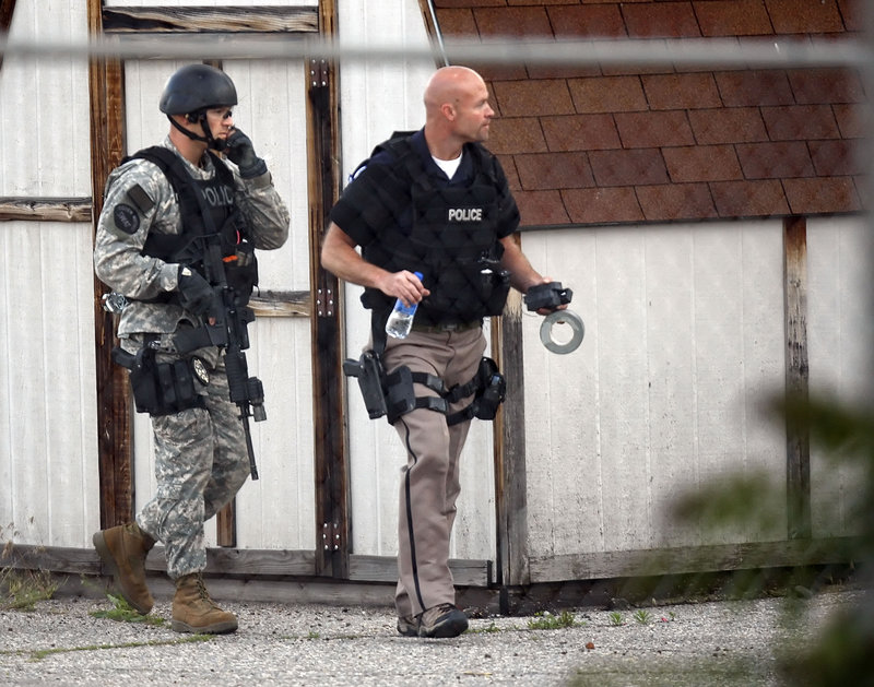 Ogden, Utah, police respond Friday to a hostage situation at the Western Colony Inn. The suspect, Jason Valdez, posted status updates on Facebook during the standoff.