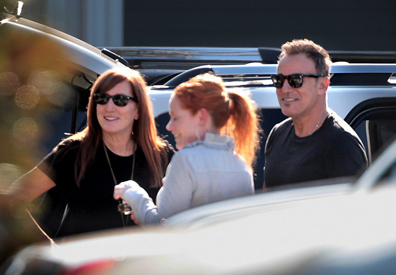 Bruce Springsteen and wife Patti Scialfa, left, leave a chapel Tuesday in Palm Beach, Fla., after a memorial service for Clarence Clemons, longtime member of Springsteen's E Street Band.