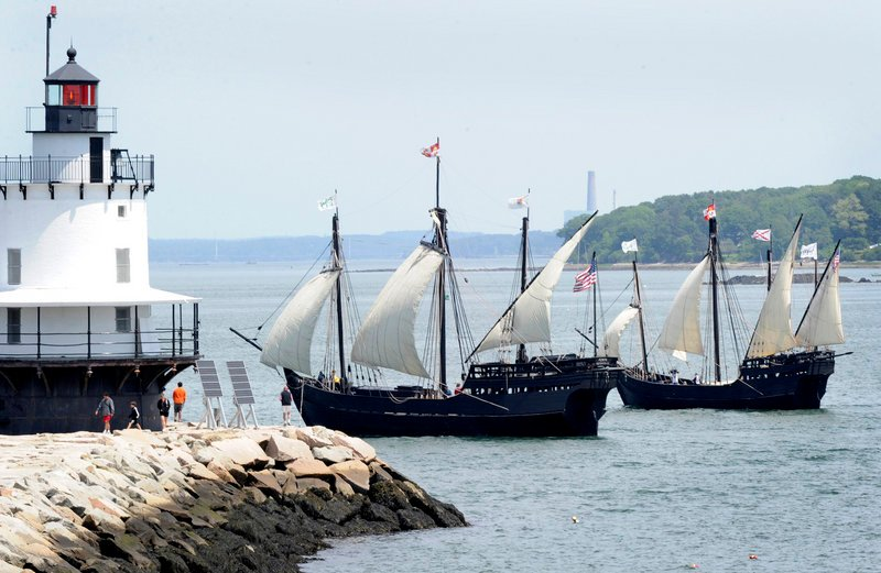 Replicas of the Pinta, left, and the smaller Nina navigate past Spring Point Ledge Lighthouse as they arrive in Portland Harbor on Wednesday for a five-day visit.
