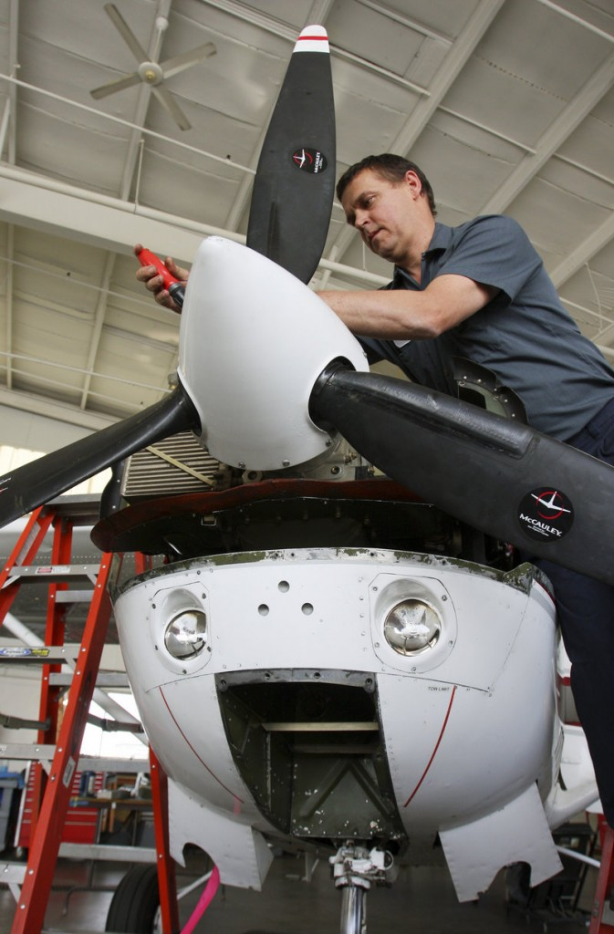 """At Northeast Air in Portland, mechanic Will Andrews works on a plane Wednesday. On July 1, Maine ends the 5 percent sales taxes on aircraft parts. """"We know our business is going to go up,"""" says a Maine Aviation official."""