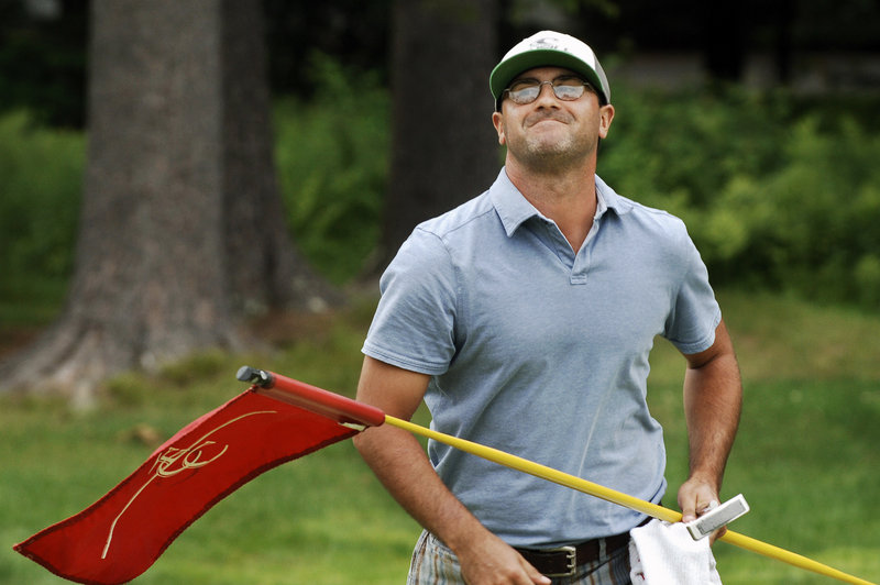 Michael Carbone allows himself a winner's grin after John Hickson's missed par putt on the first hole of a three-way playoff clinches Carbone's victory Wednesday in the Charlie's Maine Open at Falmouth Country Club.