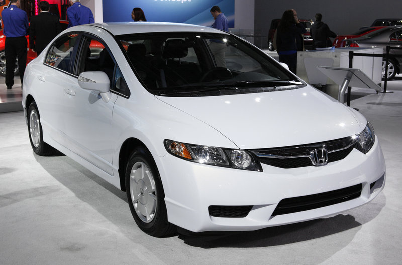 A 2011 Honda Civic Hybrid is displayed at an auto show in Detroit. The Civic earned the highest initial quality ranking for compact cars in a J.D. Power and Associates study.