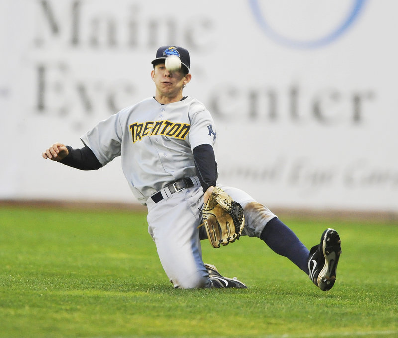 Trenton right fielder Damon Sublett attempts a sliding catch of a pop fly by Portland's Alex Hassan, but the ball drops for a hit, one of two by Hassan in the Thunder's 6-2 victory Thursday night at Hadlock Field.
