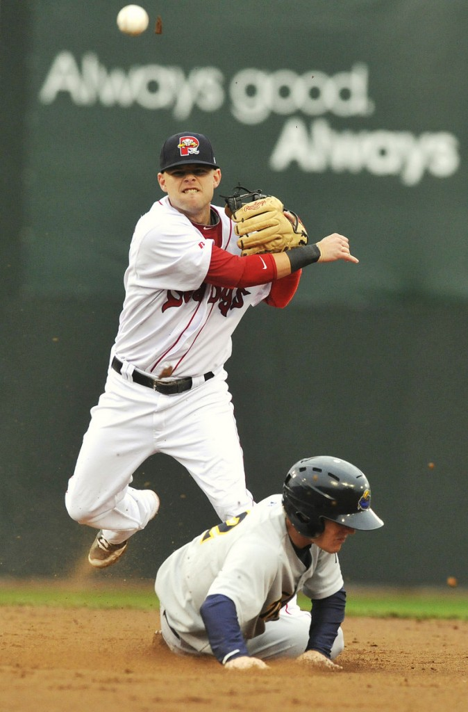 Sea Dogs shortstop Ryan Khoury throws to first over the sliding Corban Joseph of the Thunder to complete a double play in the third inning Thursday night at Hadlock Field.
