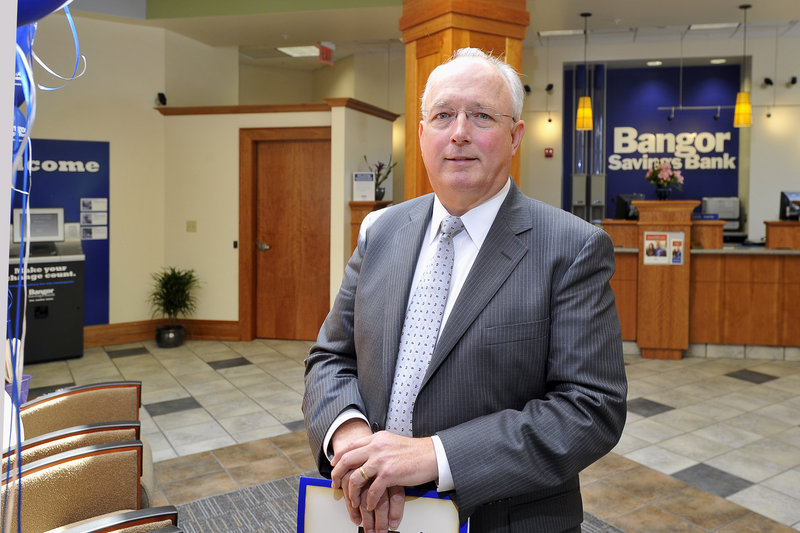 Bangor Savings Bank CEO James Conlon stands in the lobby of the new Falmouth branch.