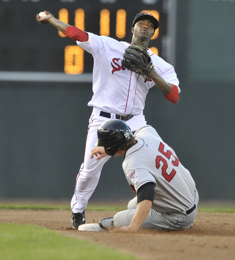 Portland second baseman Vladamir Frias forces out New Britain baserunner Mark Dolenc in the second inning, but his throw is too late for a double play.