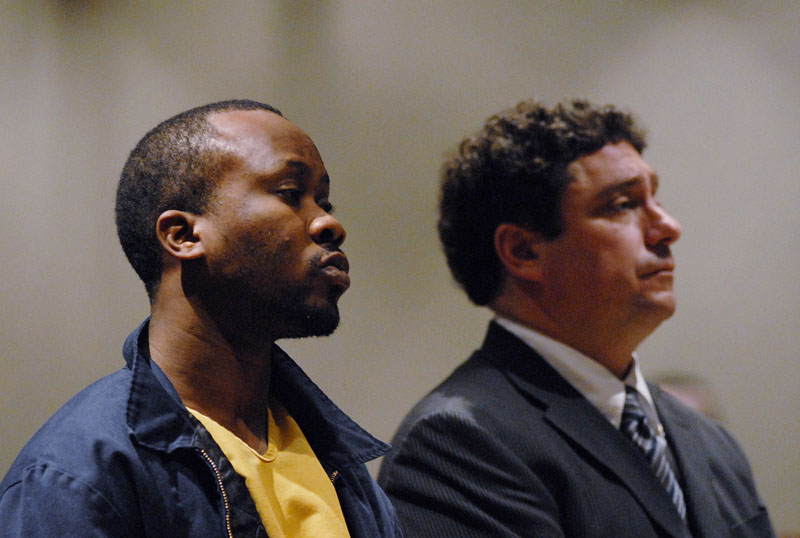 Staff Photo by Shawn Patrick Ouellette: Daudoit Butsitsi appears in court with his lawyer Anthony Sineni. Butsitsi is charged with gunning down a 24-year-old Serge Mulongo. Tuesday, Feb 16, 2010.