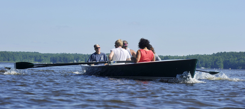 "Chuck Mainville, left, and members of his community rowing program on the Kennebec River in Bath during a recent outing. ""I get more than I give,"" said Mainville."