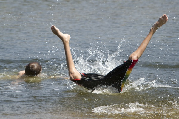 Chase Coro, 14 of Saco, seeks relief from the heat with a plunge into Goosefare Brook in Saco on Friday July 22 , 2011.