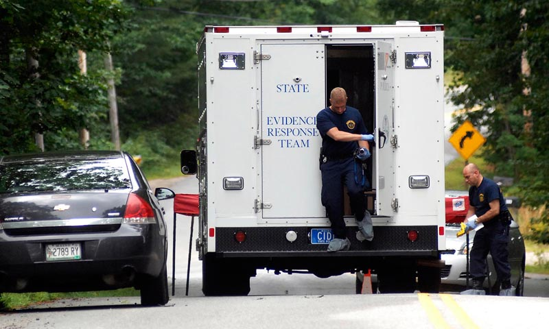 State Police collect evidence at the scene of a double shooting at 322 Bennett Road, New Gloucester Tuesday, July 26, 2011.
