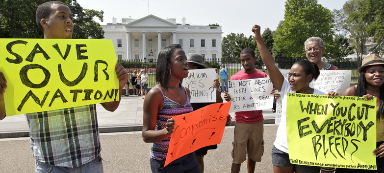 College students march at the White House on Saturday in an appeal to President Obama and congressional leaders to reach a compromise on the debt limit.
