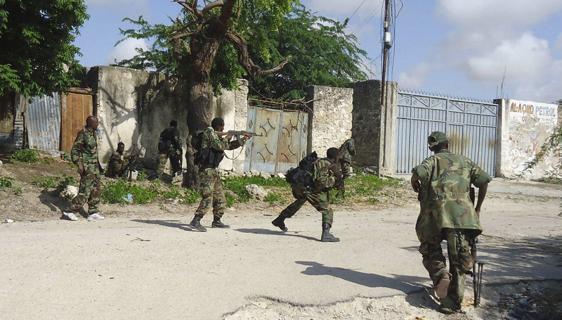 Heavy fighting erupted in Somalia's capital as African Union and Somali troops launched an offensive aimed at protecting famine relief efforts from attacks by al-Qaida-linked al-Shabab militants.