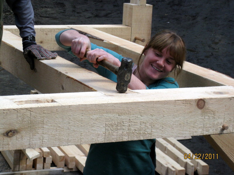 Marnie Briggs of Bath assembles a mortise and tenon joint during a timber-framing class earlier this year. A four-day class will be offered July 16, 17, 23 and 24 at Hidden Valley Nature Center in Jefferson.