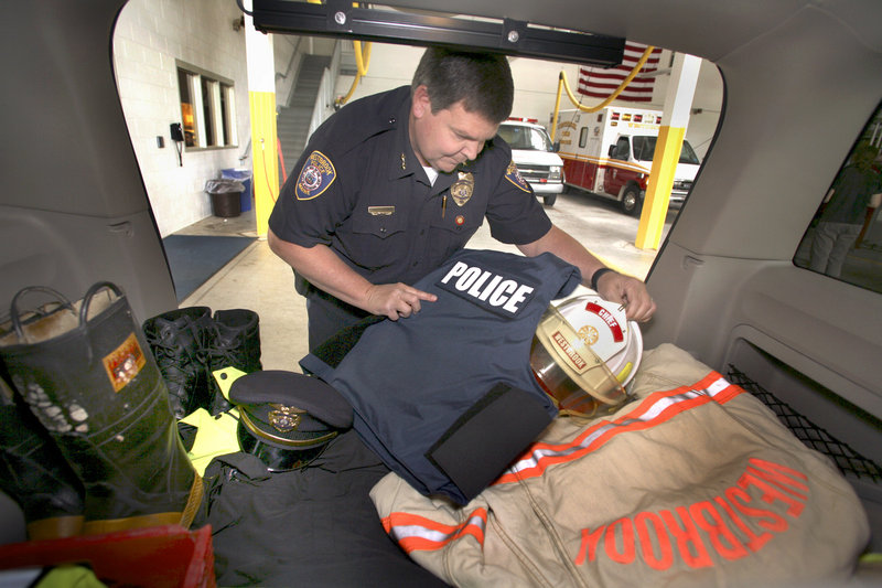 Westbrook Public Safety Director Mike Pardue keeps both his fire and police equipment ready to go in the back of a car at the Public Safety Building.