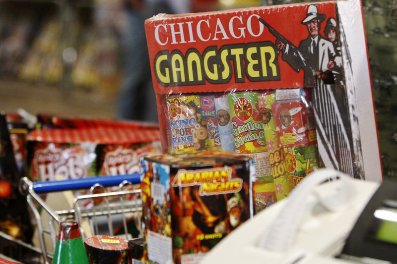 A customer checks out at the cash register in Fireworks Warehouse in Oklahoma City, Friday, July 1, 2011. Due to the severe drought, many counties across the nation are banning the use of fireworks. (AP Photo/Sue Ogrocki)