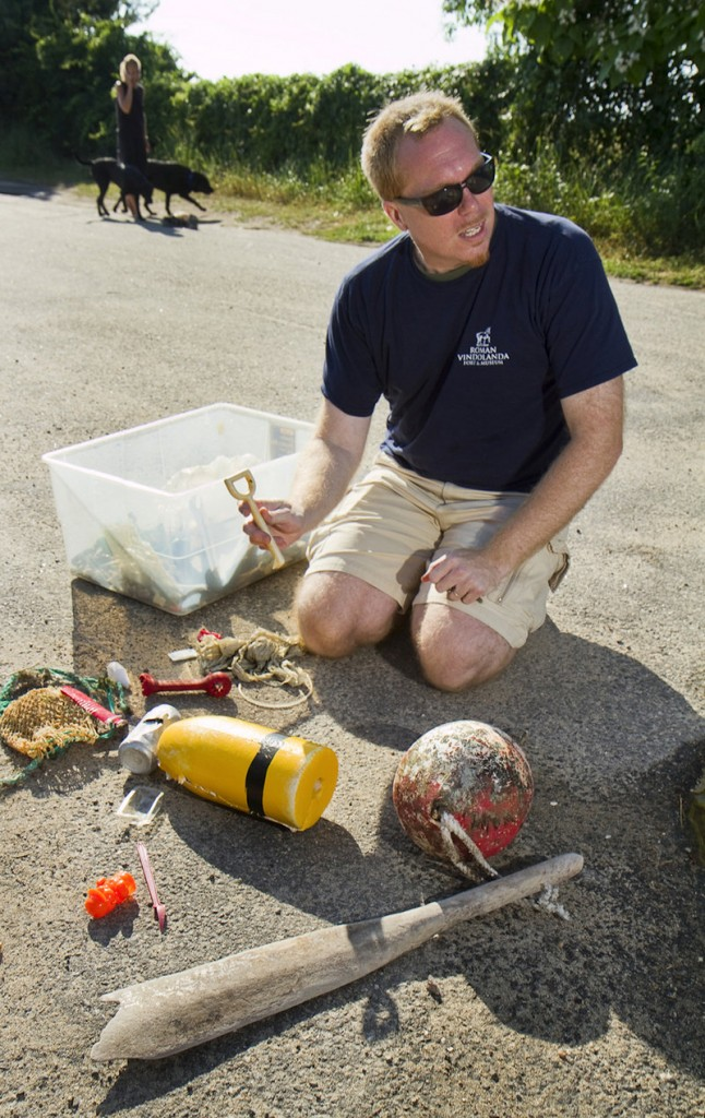 Harold Johnson of Saco displays some of the debris he has collected on Bay View Beach in Saco. Most of what he finds during his weekly cleanup is made of plastic.