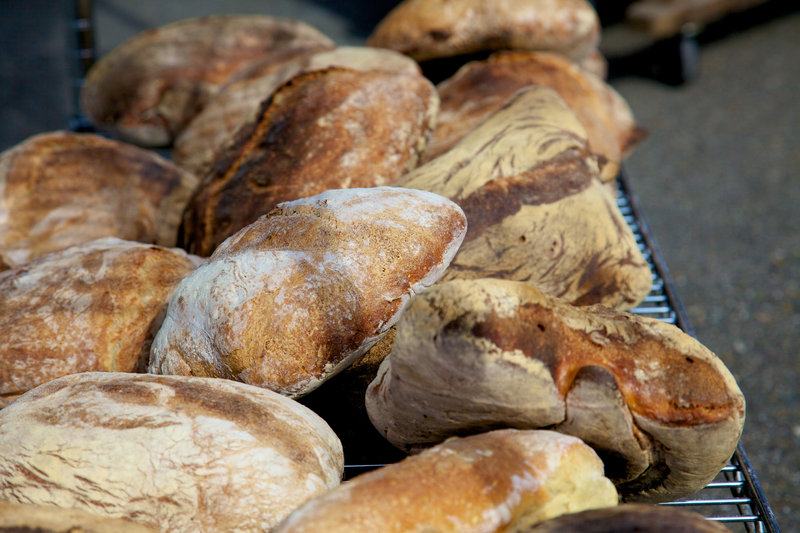 Loaves of many kinds are sold at the popular Artisan Bread Fair on the last day of the Kneading Conference in Skowhegan.