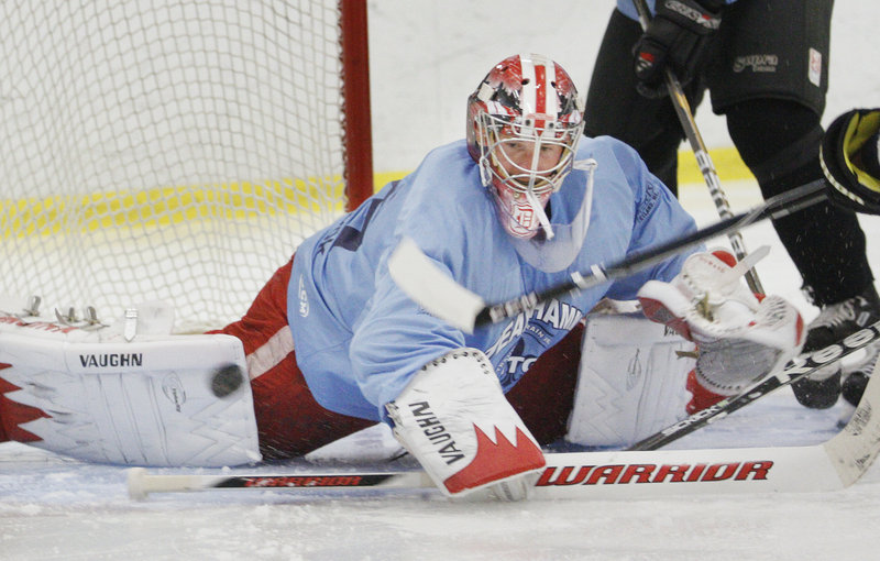 Jimmy Howard scrambles for the puck recently during a charity game held to raise money for brain injury and seizure research. It was Howard's first time on skates since his NHL season ended.