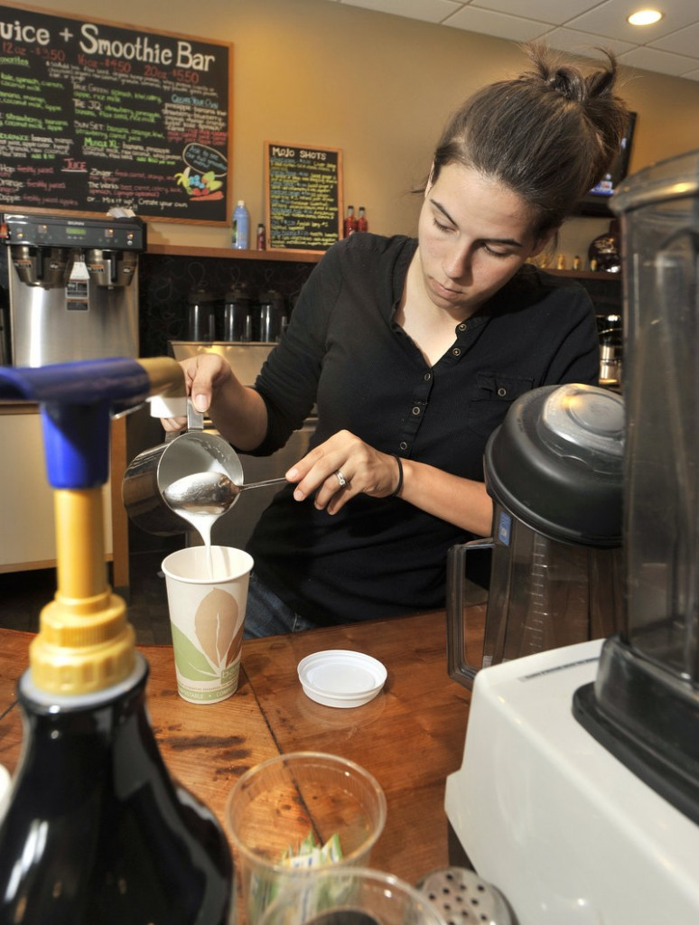 Barista Katherine McWilliams prepares a latte. Massages, aromatherapy, stone work and other stress relievers are offered, too.