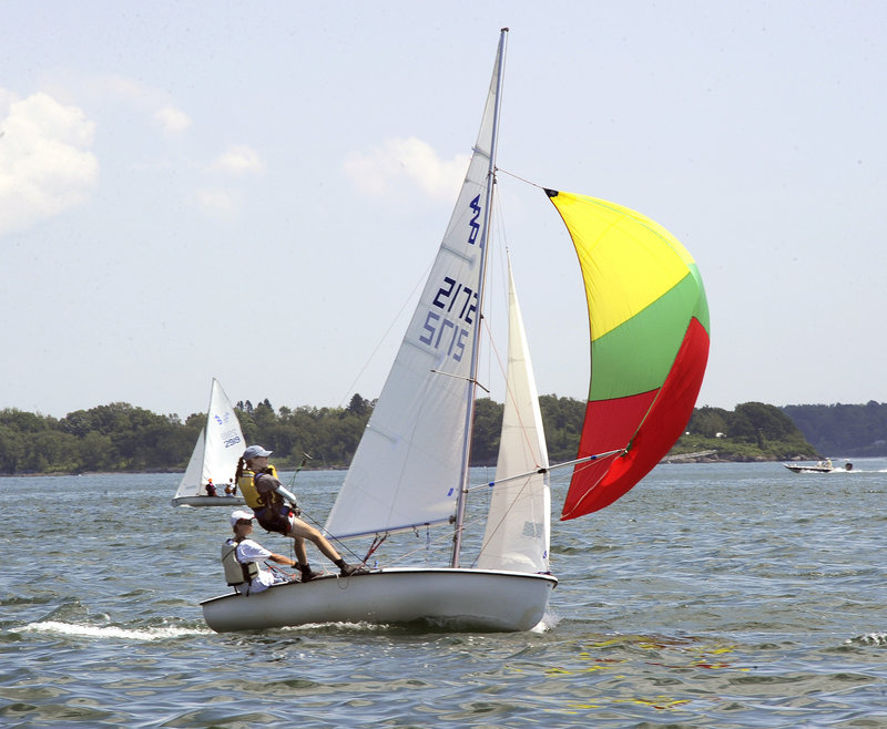James Collins and Antonia Leggett maneuver their 420 class sailboat Tuesday during a USA Junior Olympics race in Portland. The event involves about 100 boats in three classes.
