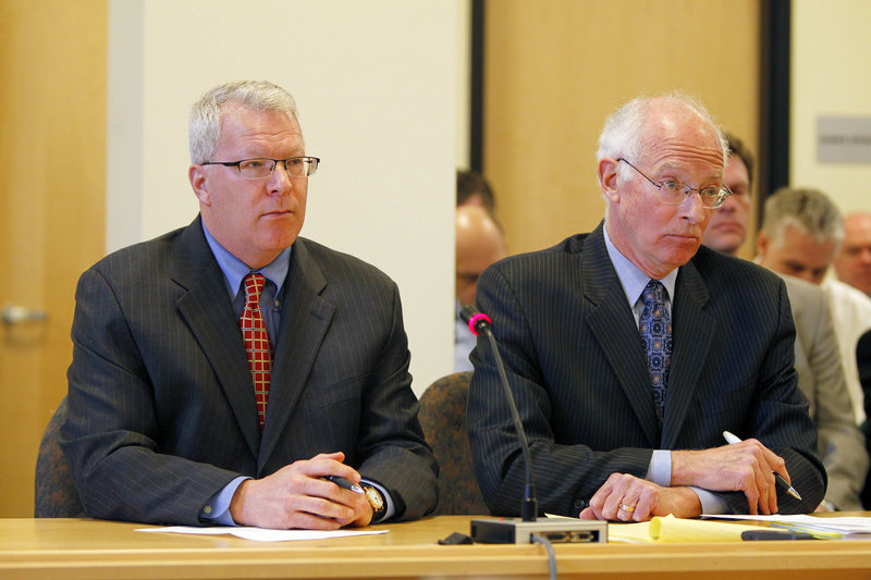 Paul Violette, former executive director of the Maine Turnpike Authority, left, with attorney Peter DeTroy, appears before the Legislature's Government Oversight Committee on April 15 in Augusta. Violette invoked his constitutional right against self-incrimination and refused to answer questions about the authority's spending practices.