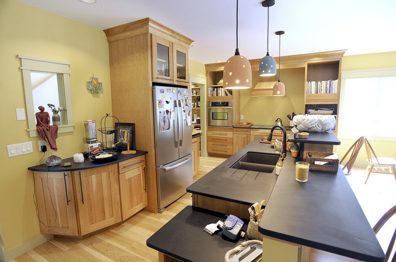 In the kitchen, countertops are made of recycled materials, and work areas are extra wide to allow for wheelchair or walker use.