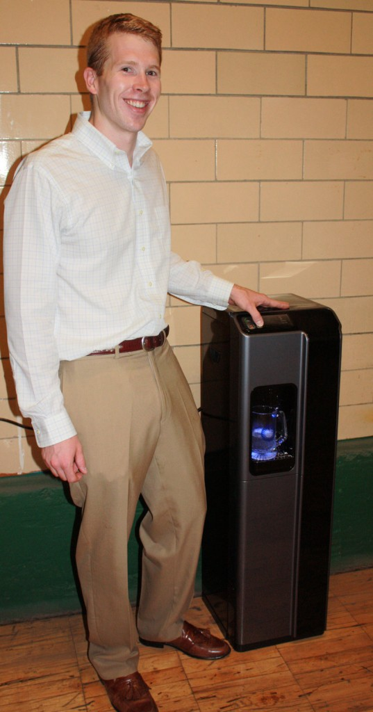 Brandon Pollock, one of the founders of Blue Reserve, shows off one of the company's water coolers, an alternative to buying bottled water.