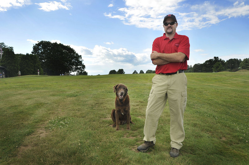 Brendan Parkhurst of Cape Arundel Golf Club in Kennebunkport with his dog Moose on the 18th tee. Parkhurst, superintendent of the golf course for 10 years, majored in turf grass science at Penn State.