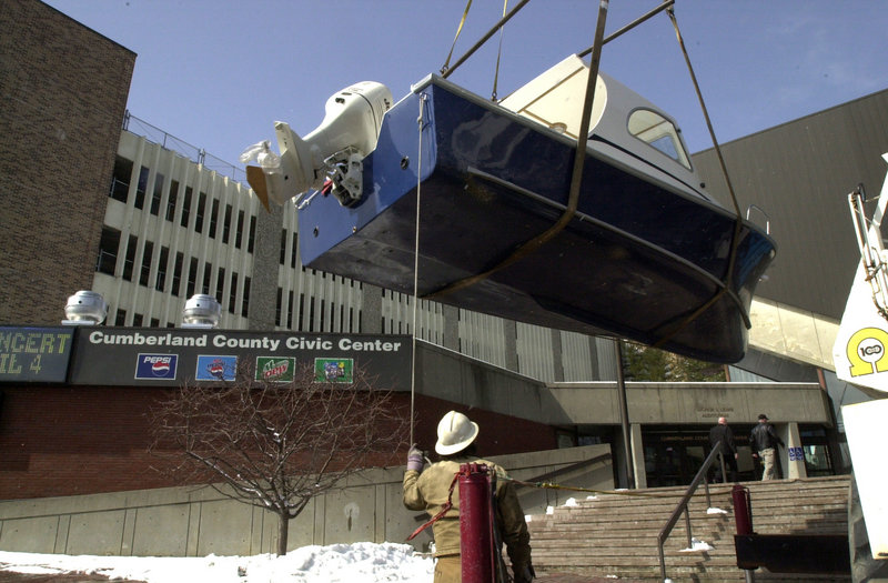 A boat is unloaded for a commercial show at the Cumberland County Civic Center. A November vote is about more than the price of renovating the building; it also is about whether the county should stay in the entertainment business.