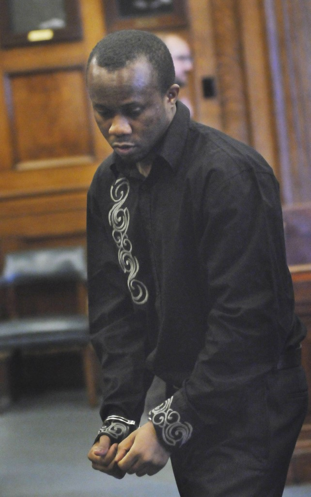 Daudoit Butsitsi leaves court in handcuffs Thursday after a jury found him guilty of murdering Serge Mulongo in the entryway of a Park Avenue apartment building on Feb. 10, 2010. He faces a sentence of 25 years to life in prison.