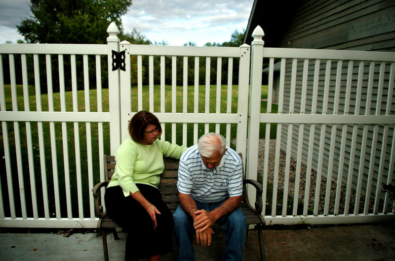 A woman visits with her father at the Nottingham Place senior living center in 2007 in Midland, Mich. Estimates are that half of people who meet medical criteria for dementia have not been diagnosed with it, and many who are told they have it don't.