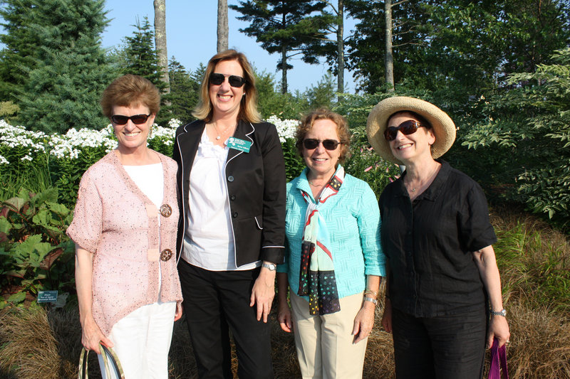 Board member Karen Bartholomew, who summers in Boothbay Harbor, Executive Director Maureen Heffernan, board member Martha Heald, who summers in Southport, and board member Ina Heafitz, who summers in Edgecomb, at the Tastefully Maine Party at Coastal Maine Botanical Gardens on Thursday.