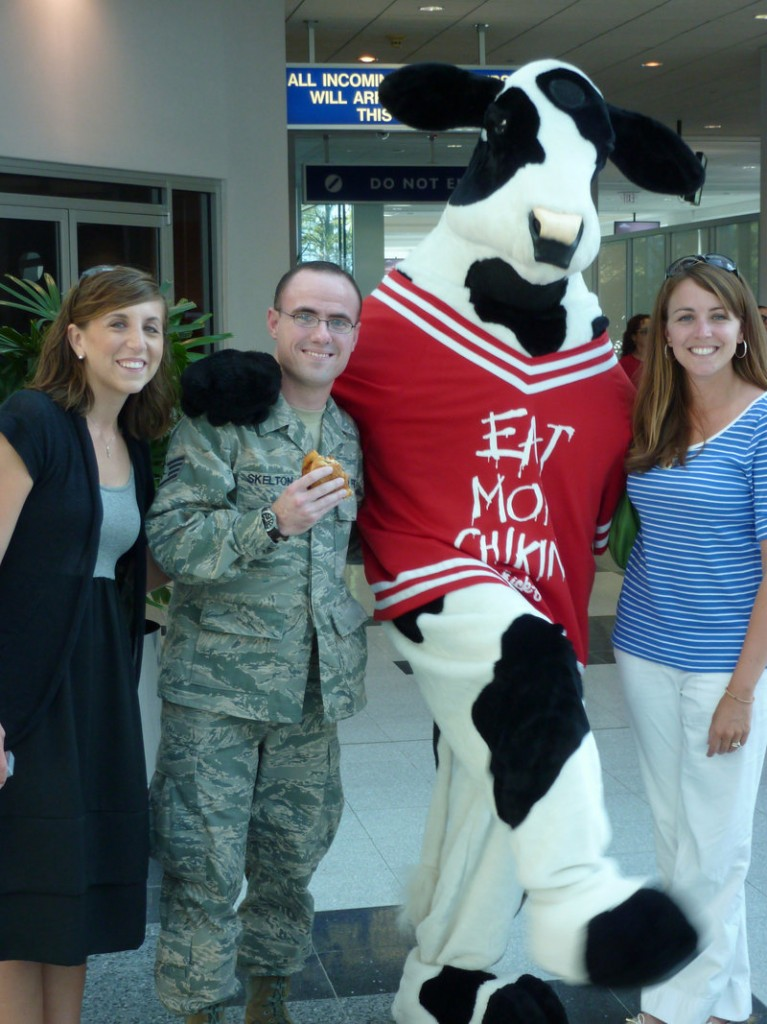 Ben Skelton of Concord, N.C., poses in 2010 with the Chick-fil-A cow mascot, who was to be the best man at Skelton's wedding.