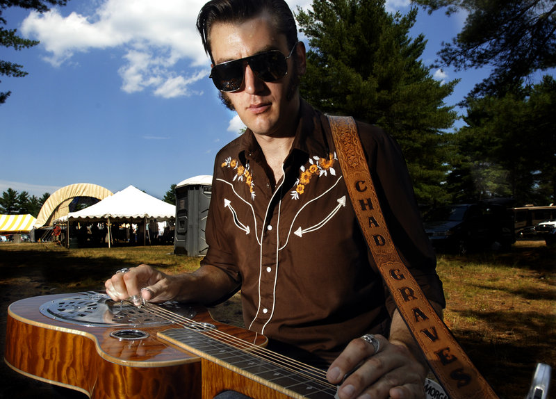 Chad Graves, a dobro player with The Hillbenders, of Springfield, Mo., practices before playing his set Friday at the Ossipee Valley Fairgrounds.