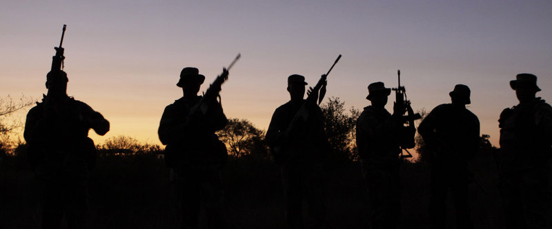 Armed soldiers stage a night patrol at an isolated outpost in South Africa's Kruger National Park this week. Soldiers, park officials, judicial, customs and tax officers are coordinating a multi-pronged strategy to combat rhino poaching in the country's flagship park. Poachers killed 333 rhino in South Africa last year, and will likely top 400 this year.