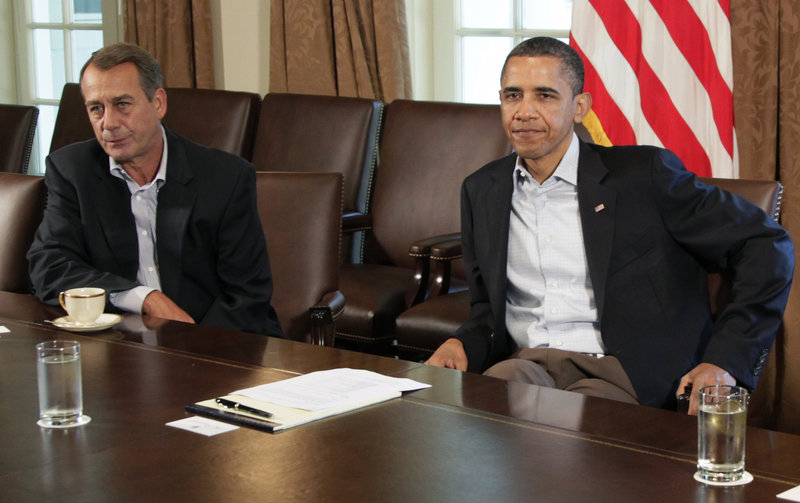 President Barack Obama and House Speaker John Boehner of Ohio, left, meet to discuss the debt deal – or lack of one – in the Cabinet Room of the White House on Saturday.