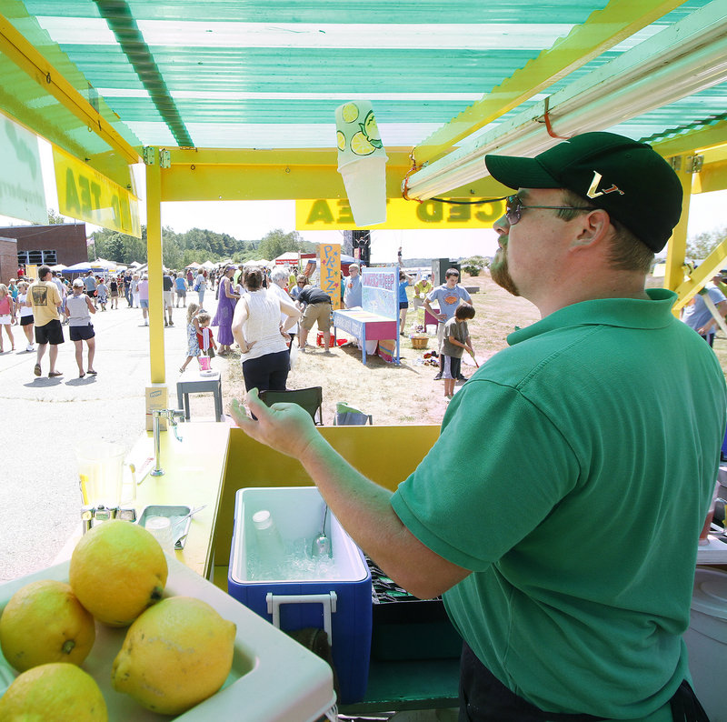 John Frake mixes lemonade for festival-goers.