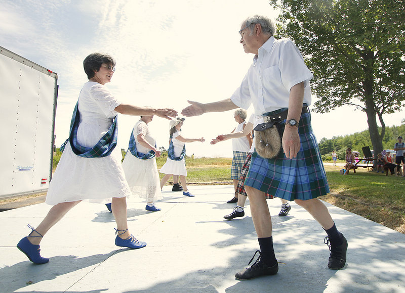 Scottish country dancers Ruth Knippa of Bowdoin and Kenneth Wilson of Gray step lively.