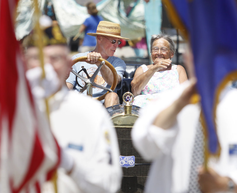 Ruth Weeks of Harpswell, parade grand marshal, rides with Rob Roark in his 1910 Chalmers Detroit.