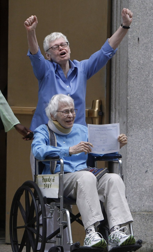 Phyllis Siegel, 77, arms raised, and Connie Kopelov, 85, both of New York, celebrate after becoming the first gay couple to marry in Manhattan, N.Y., on Sunday.