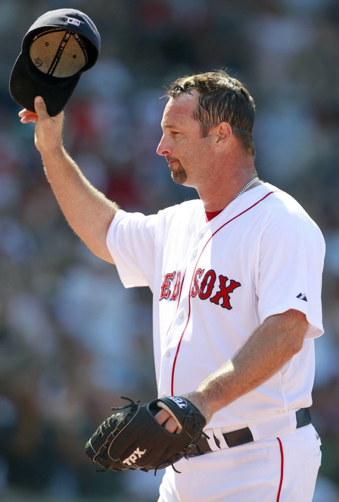 Boston's Tim Wakefield tips his cap to acknowledge an ovation after he recorded his 2,000th strikeout Sunday.