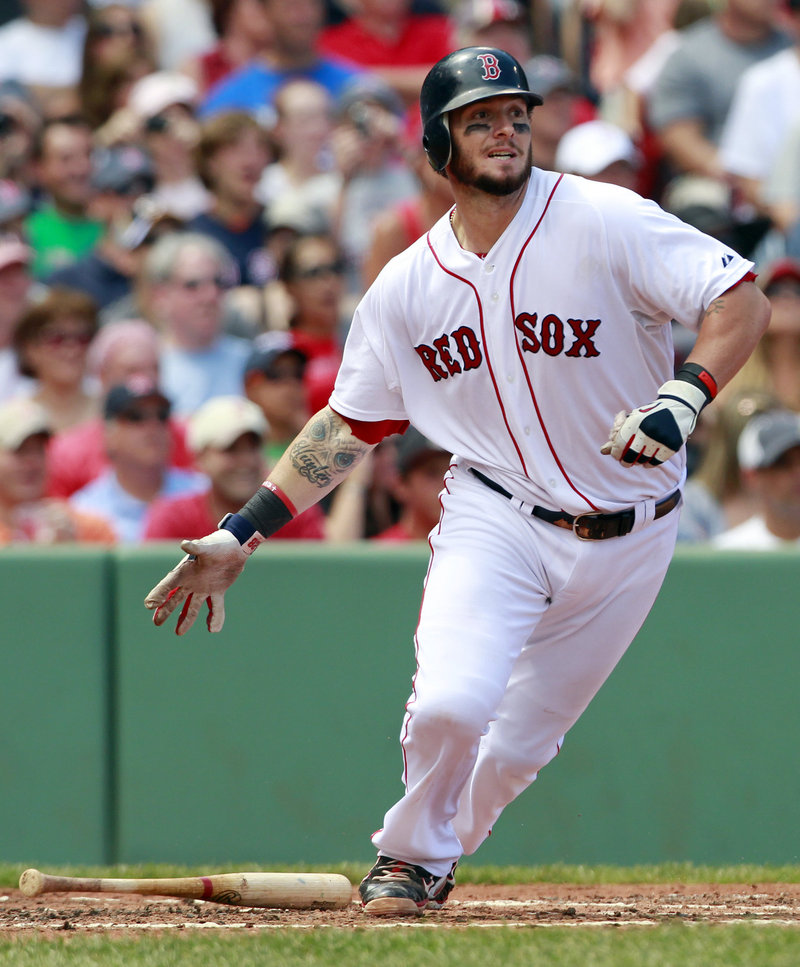 Boston's Jarrod Saltalamacchia watches his two-run single in the first inning of a 12-8 win over Seattle at Fenway Park on Sunday. The Red Sox catcher had three hits and four RBI.