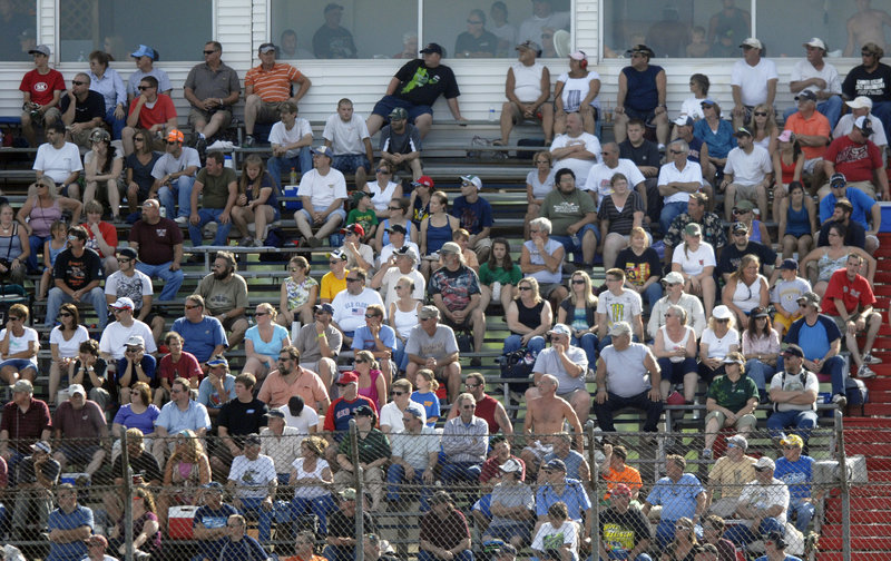 Fans take in the action at OPS on Sunday during qualifying for the TD Bank 250. More than 80 teams signed up to compete for 39 slots on the starting grid.