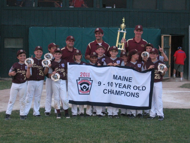 The Saco Little League All-Stars took a pair of key tournaments this summer, with a win in the District 4 tournament as well as a state championship. The win advances the team to the regional tournament in Providence, R.I. Pictured are Luke Chessie, front left, Ean Patry, Michael Bourgault (rear), Hunter Penley, Timmy Smith, Anthony Bracamonte, Andrew DeGeorge (rear), Zachary Ahmida, Eric McCallum (rear), Caleb LaCroix, Brogan Searle-Belanger and Matthew Duchaine (rear). In the back assistant coach James Searle-Belanger, assistant coach Ryan Chessie and Manager Todd Duchaine.