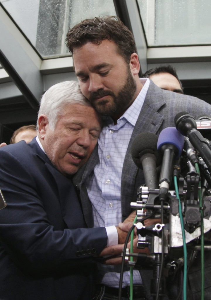 Patriots owner Robert Kraft and player rep Jeff Saturday embrace after a mention of Myra Kraft, who died July 20.