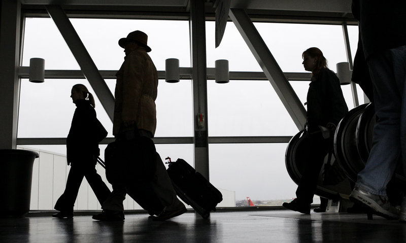 Passengers arrive for flights out of Cleveland Hopkins Airport in Ohio in this file photo. Most U.S. airlines have raised fares to offset any savings to customers from taxes that expired over the weekend.