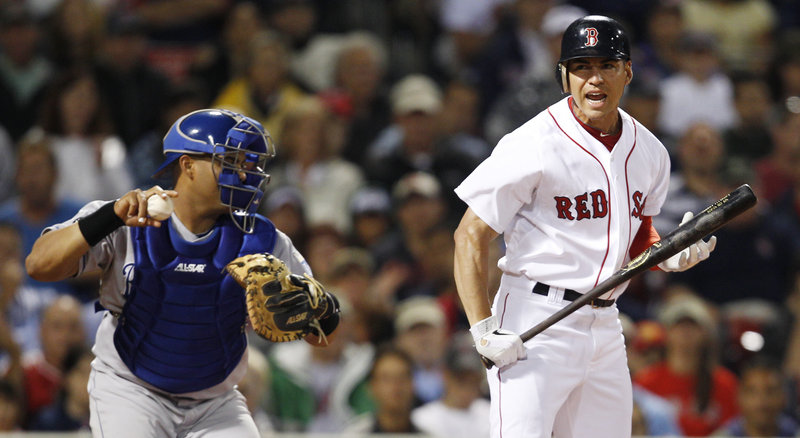 Jacoby Ellsbury, right, reacts after striking out against the Royals on Monday night at Fenway. The teams endured a 2-hour, 21-minute rain delay. The score was tied at 1 after 10 innings.