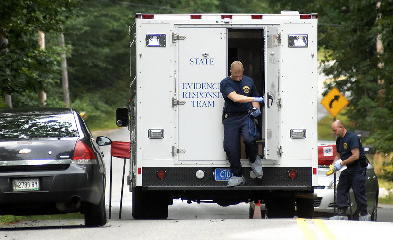 State police prepare to collect evidence Tuesday at the scene of Monday's shooting of two people outside a mobile home in New Gloucester. Police said there was a history of domestic violence between the suspected shooter and Renee Sandora, who was killed.