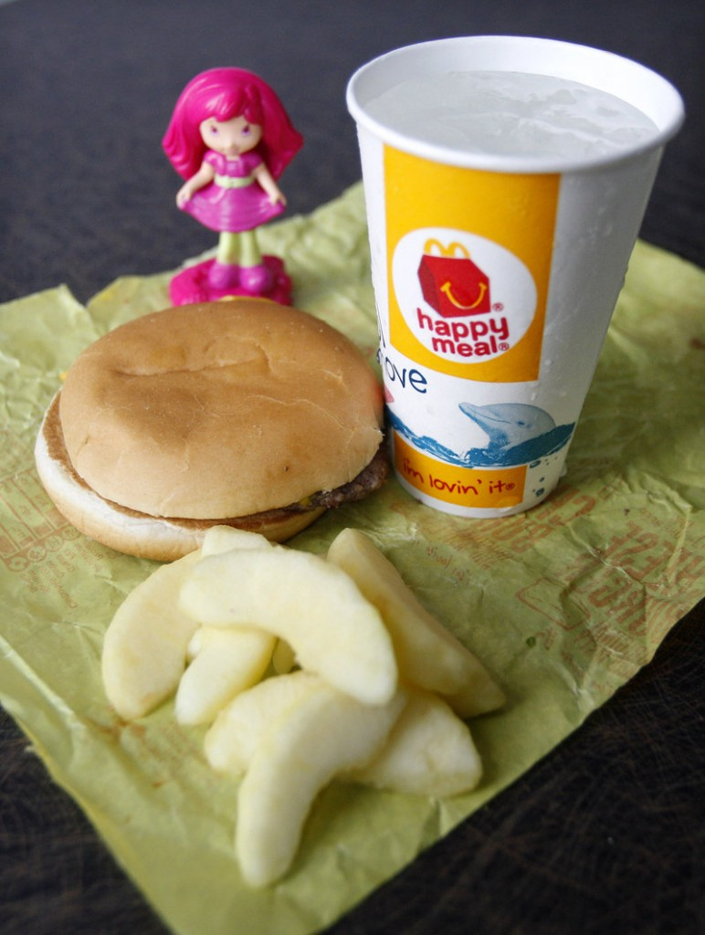 The Happy Meal will get healthier this fall; some critics say the move is more about public relations than nutrition.