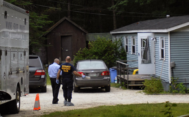 "A man who works near the mobile home, above, reported hearing three shots Monday, followed by a dialogue in which a girl said ""He didn't do anything,"" then three more shots."